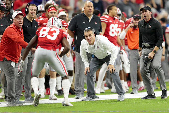 Ohio State head coach Urban Meyer celebrates a touchdown reception by wide receiver Terry McLaurin (83) during the first half of the Big Ten championship NCAA college football game against Northwestern, Saturday, Dec. 1, 2018, in Indianapolis. (AP Photo/AJ Mast)
