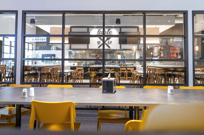 Table 1867 is one of several new restaurants at the remodeled Illinois Street Residence Hall dining area, at the University of Illinois, in Urbana, Ill. (Anthony Zilas/The News-Gazette via AP)