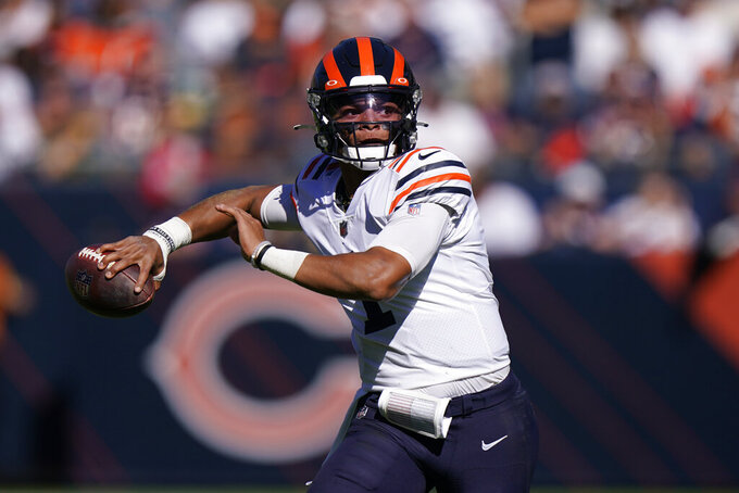 Chicago Bears quarterback Justin Fields passes during the first half of an NFL football game against the Green Bay Packers Sunday, Oct. 17, 2021, in Chicago. (AP Photo/Nam Y. Huh)