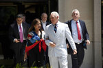 Roger Stone, a longtime confidant of President Donald Trump, accompanied by his wife, Nydia Stone, leaves federal court in Washington, Tuesday, July 16, 2019. (AP Photo/Sait Serkan Gurbuz)