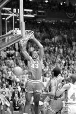 FILE - This April 4, 1983, file photo shows North Carolina State's Lorenzo Charles (43) dunking the ball against Houston in the NCAA Championship game in Albuquerque, N.M. Charles' dunk shot with one second remaining fulfilled North Carolina State's impossible dream, giving the Wolfpack a 54-52 victory over top-ranked Houston for the NCAA basketball championship. (AP Photo/File)