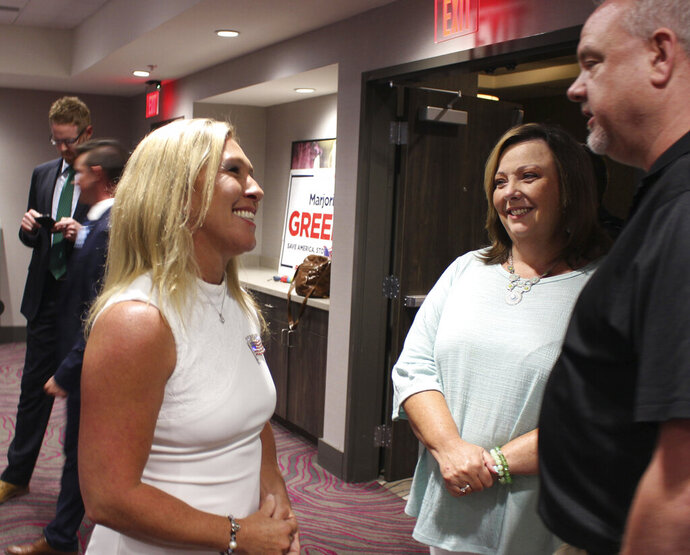 In this June 9, 2020, photo, U.S. House District 14 candidate Marjorie Taylor Greene talks with attendees at her watch party on at the Courtyard by Mariott in Rome, Ga. (Olivia Morley/The Rome News-Tribune via AP)