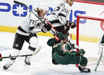 Minnesota Wild's Jared Spurgeon, right, is upended by Los Angeles Kings' Jeff Carter (77) in the first period of an NHL hockey game, Tuesday, Jan. 26, 2021, in St. Paul, Minn. (AP Photo/Jim Mone)