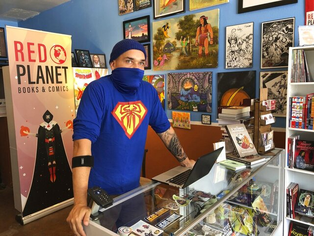 This Aug. 19, 2020, image shows Aaron Cuffee of Red Planet Books & Comics in Albuquerque, N.M., as he discusses the potential that could come from Marvel Comics' effort to assemble a gallery of Native artists and scribes for