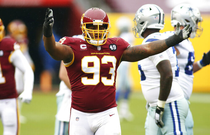 FILE - Washington Football Team defensive tackle Jonathan Allen (93) gestures during an NFL football game against the Dallas Cowboys in Landover, Md., in this Sunday, Oct. 25, 2020, file photo. Washington signed star defensive tackle Jonathan Allen on the eve of training camp to a $72 million, four-year contract extension with a $30 million signing bonus. Allen's agency, Team IFA, announced the terms of the deal in a Twitter post Monday, July 26, 2021. (AP Photo/Daniel Kucin Jr., File)
