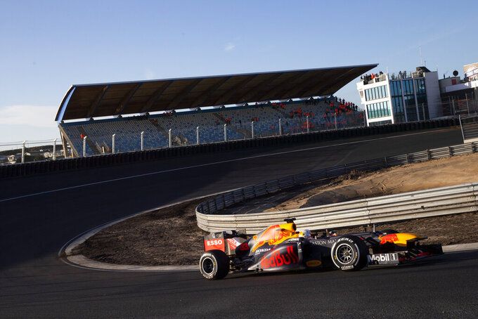 F1 driver Max Verstappen of The Netherlands drives his car through one of the two banked corners during a test and official presentation of the renovated F1 track in the beachside resort of Zandvoort, western Netherlands, Wednesday, March 4, 2020. (AP Photo/Peter Dejong)