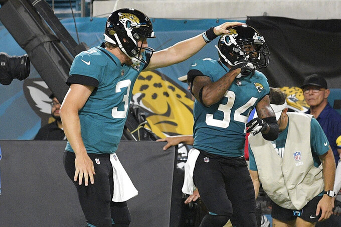Jacksonville Jaguars quarterback C.J. Beathard (3) congratulates wide receiver Tavon Austin (34) after a reception for a touchdown against the Cleveland Browns during the second half of an NFL preseason football game Saturday, Aug. 14, 2021, in Jacksonville, Fla. (AP Photo/Phelan M. Ebenhack)