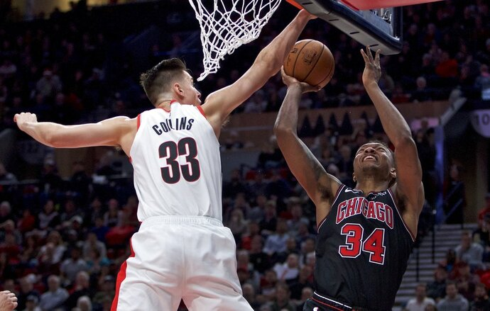 Chicago Bulls forward Wendell Carter Jr., right, shoots over Portland Trail Blazers forward Zach Collins during the second half of an NBA basketball game in Portland, Ore., Wednesday, Jan. 9, 2019. (AP Photo/Craig Mitchelldyer)