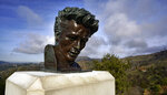 In this Friday, Jan. 17, 2020, photo, the Hollywood hills are seen behind a bust of actor James Dean at the Griffith Observatory in Los Angeles. Travis Cloyd, who is leading the revival of Dean for his appearance in