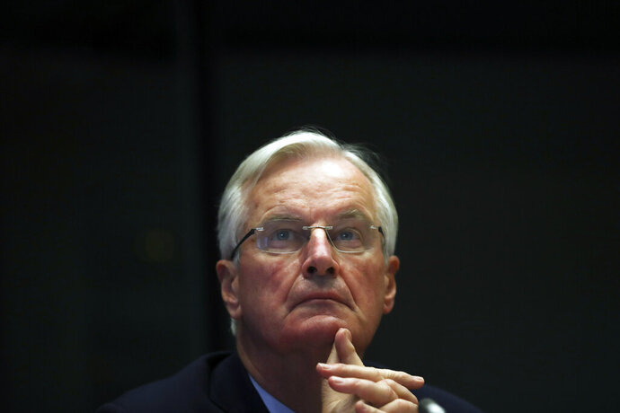 European Union chief Brexit negotiator Michel Barnier attends a debate on post-Brexit relations with United Kingdom at the European Parliament in Brussels, Wednesday, Oct. 30, 2019. A respected British think tank slammed Prime Minister Boris Johnson's Brexit deal on Wednesday, concluding that the economy would be 3.5% smaller over the next decade compared with staying in the European Union. (AP Photo/Francisco Seco)