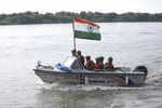 Indian Border Security Force (BSF) soldiers patrol on a boat in river Chenab at Pargwal area along the India-Pakistan border in Akhnoor, about 55 kilometers (34 miles) west of Jammu, India, Tuesday, Aug.13, 2019.  Pakistan has denounced India's actions to change the special status of the disputed Himalayan region of Kashmir and has downgraded its diplomatic ties with New Delhi. (AP Photo/Channi Anand)