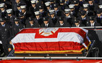 Fallen firefighter Steven Pollard's casket is driven on his fire house truck through a roadway lined with thousands of firefighters, Friday, Jan. 11, 2019, in New York. The 30-year-old was assigned to Ladder 170 of the Fire Department of New York when he was fatally injured last Sunday on Brooklyn's Belt Parkway. (AP Photo/Bebeto Matthews)