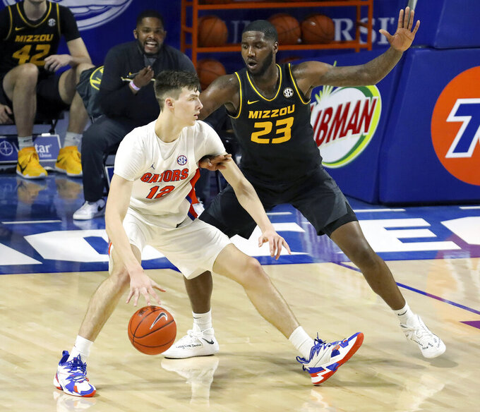 Florida forward Colin Castleton (12) drives the ball during an NCAA college basketball game against Missouri, Wednesday, March 3, 2021 in Gainesville, Fla. (Brad McClenny/The Gainesville Sun via AP)