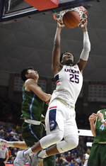 Connecticut's Josh Carlton (25) dunks over Tulane's Kevin Zhang during the second half of an NCAA college basketball game, Saturday, Jan. 19, 2019, in Storrs, Conn. (AP Photo/Jessica Hill)