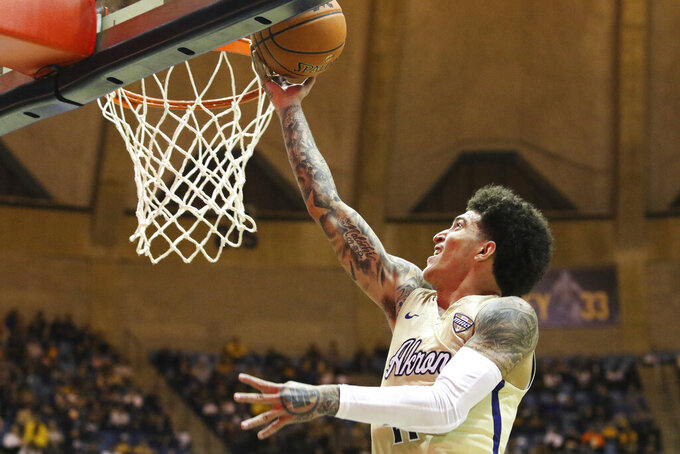 CORRECTS TO CHANNEL BANKS, INSTEAD OF LOREN CRISTIAN JACKSON - Akron's Channel Banks goes to the basket against West Virginia during an NCAA college basketball game, Friday, Nov. 8, 2019, in Morgantown, W.Va. (AP Photo/Kathleen Batten)