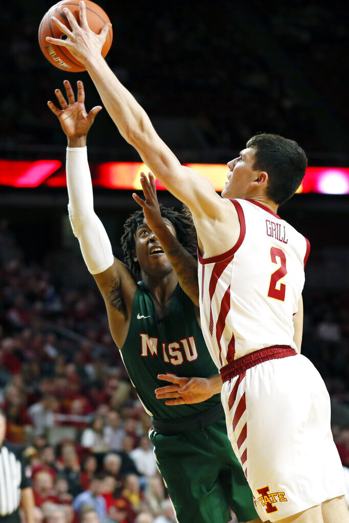 Iowa State guard Caleb Grill, right, blocks a shot by Mississippi Valley State guard Torico Simmons, left, during the second half of an NCAA college basketball game, Tuesday, Nov. 5, 2019, in Ames, Iowa. Iowa State won 110-74. (AP Photo/Charlie Neibergall)