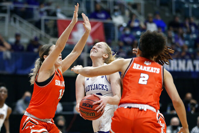 Stephen F. Austin guard Stephanie Visscher, middle, puts up a shot between Sam Houston State forward Kaylee Jefferson (13) and forward Amber Leggett (2) during the first half of an NCAA college basketball game for the Southland Conference women's tournament championship Sunday, March 14, 2021, in Katy, Texas. (AP Photo/Michael Wyke)
