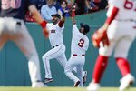 Boston Red Sox's Jonathan Arauz (3) makes the catch beside J.D. Martinez on a popout by Cleveland Indians' Andres Gimenez during the third inning of a baseball game, Saturday, Sept. 4, 2021, in Boston. (AP Photo/Michael Dwyer)