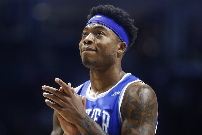 Xavier's Tyrique Jones reacts in the final seconds of the second half of an NCAA college basketball game against Marquette, Saturday, Jan. 26, 2019, in Cincinnati. (AP Photo/John Minchillo)