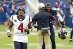 Houston Texans quarterback Deshaun Watson (4) leaves the field after losing to the Tennessee Titans in overtime of an NFL football game Sunday, Oct. 18, 2020, in Nashville, Tenn. The Titans won 42-36. (AP Photo/Mark Zaleski)