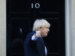 Britain's Prime Minister Boris Johnson gestures after applauding on the doorstep of 10 Downing Street, during the weekly