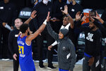 Denver Nuggets' Jamal Murray (27) celebrates with teammates after an NBA basketball first round playoff game against the Utah Jazz Sunday, Aug. 30, 2020, in Lake Buena Vista, Fla. The Nuggets won 119-107. (AP Photo/Ashley Landis)