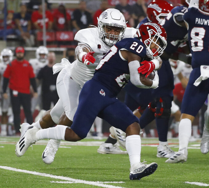 UNLV linebacker Kylan Wilborn wraps up Fresno State running back Ronnie Rivers during the first half of an NCAA college football game in Fresno, Calif., Friday, Sept. 24, 2021. (AP Photo/Gary Kazanjian)