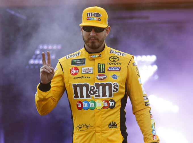Kyle Busch waves to fans during driver introductions for the NASCAR Cup Series auto race at Richmond Raceway in Richmond, Va., Saturday, April 13, 2019. (AP Photo/Steve Helber)
