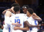 Memphis' forward Precious Achiuwa (55) leads a team huddle in the first half of an NCAA college basketball game against Tulane Monday, Dec. 30, 2019, in Memphis, Tenn. (AP Photo/Karen Pulfer Focht)