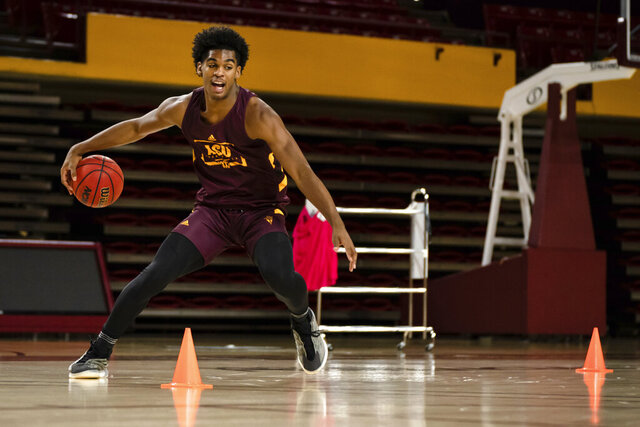 In this image provided by Sun Devil Athletics, Arizona State's Josh Christopher works out during NCAA college basketball practice on Nov. 5, 2020, in Tempe, Ariz. Christopher is blessed with prodigious basketball talent and a strong inner drive to be the best at what he does, a combination that made him one of that nation's top recruits in the class of 2020. (Katie MacCrory/Sun Devil Athletics via AP)
