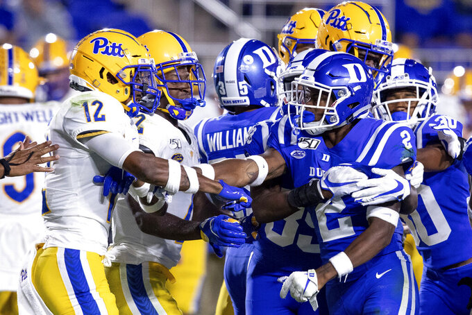 Pittsburgh's Paris Ford (12) and Duke's Javon Jackson (2) scuffle after a play during an NCAA college football game in Durham, N.C., Saturday, Oct. 5, 2019. (AP Photo/Ben McKeown)