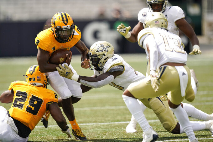 Kennesaw State quarterback Xavier Shepherd (8) is tackled by Georgia Tech linebacker Ayinde Eley (10) during the first half of an NCAA college football game, Saturday, Sept. 11, 2021, in Atlanta. (AP Photo/Brynn Anderson)