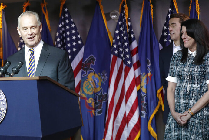 Pennsylvania Speaker of the House, Mike Turzai, left, stands the podium beside his wife Lydia, right, and one of his sons, Matt, center, as he announces at a news conference he will not run for another term as a Pennsylvania representative, Thursday, Jan. 23, 2020, in McCandless, Pa. (AP Photo/Keith Srakocic)