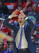 Washington head coach Mike Hopkins shouts to his team during the first half of an NCAA college basketball game against Utah, Thursday, Jan., 10, 2019, in Salt Lake City. (AP Photo/Rick Bowmer)