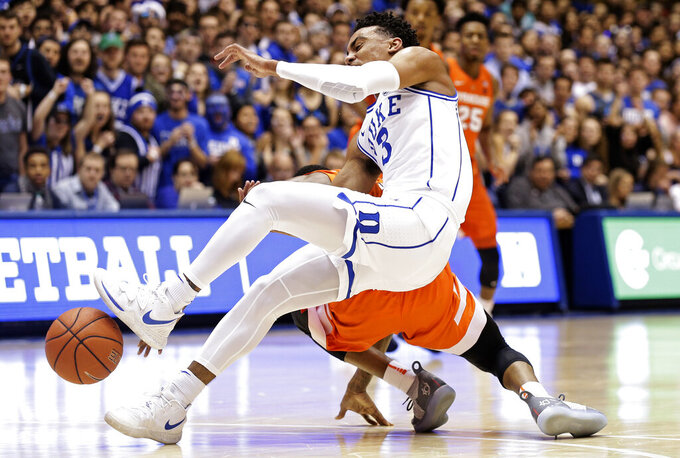 Duke's Tre Jones (3) collides with Syracuse's Frank Howard during the first half of an NCAA college basketball game in Durham, N.C., Monday, Jan. 14, 2019. Jones was injured on the play and left the court. (AP Photo/Gerry Broome)
