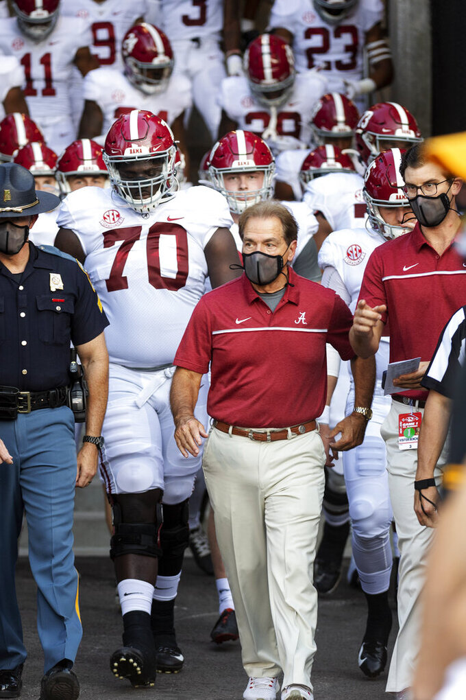 Alabama head coach Nick Saban leads his team to the field before an NCAA college football game against Missouri, Saturday, Sept. 26, 2020, in Columbia, Mo. (AP Photo/L.G. Patterson)