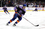 New York Islanders left wing Otto Koivula (21) wears a Hockey Fights Cancer jersey as he warms up before an NHL hockey game against the Florida Panthers, Saturday, Nov. 9, 2019, in New York (AP Photo/Jim McIsaac)
