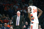 Syracuse head coach Jim Boeheim talks to forward Bourama Sidibe (34) during the second half of an NCAA college semi final basketball game against the Oklahoma State in the NIT Season Tip-Off tournament, Wednesday, Nov. 27, 2019, in New York. Oklahoma State won 86-72. (AP Photo/Mary Altaffer)
