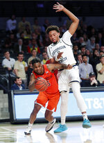 Virginia Tech guard Ahmed Hill (13) tries to stay inbounds as he drives against Georgia Tech forward James Banks III (1) in the first half of an NCAA college basketball game Wednesday, Jan. 9, 2019, in Atlanta. (AP Photo/John Bazemore)