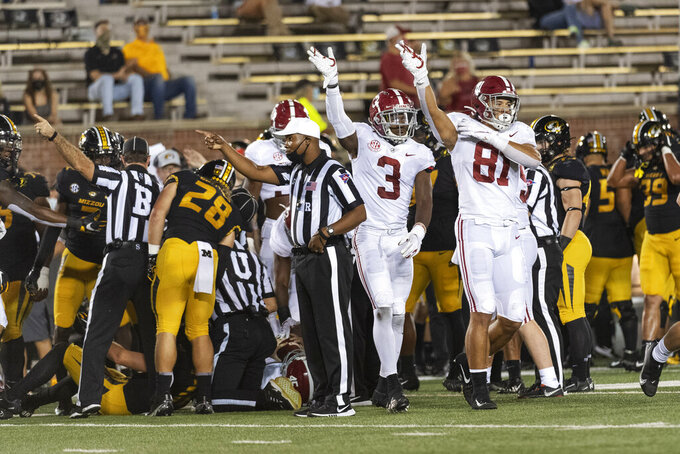Alabama players Cameron Latu, right, and Daniel Wright (3) celebrate a recovery of a Missouri fumble during the second half of an NCAA college football game Saturday, Sept. 26, 2020, in Columbia, Mo. (AP Photo/L.G. Patterson)