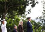 South Korea's President Moon Jae-in, right, stands with Singapore's President Halimah Yacob, second from right, while listening their national anthems during a welcome ceremony at the Istana or Presidential Palace in Singapore, Thursday, July 12, 2018. (AP Photo/Yong Teck Lim)