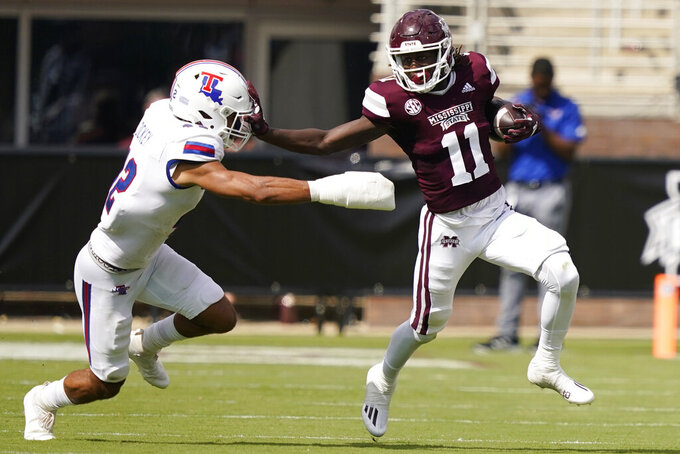 Mississippi State wide receiver Jaden Walley (11) pushes past Louisiana Tech linebacker Joren Dickey (42) after a pass reception during the first half of an NCAA college football game in Starkville, Miss., Saturday, Sept. 4, 2021. (AP Photo/Rogelio V. Solis)