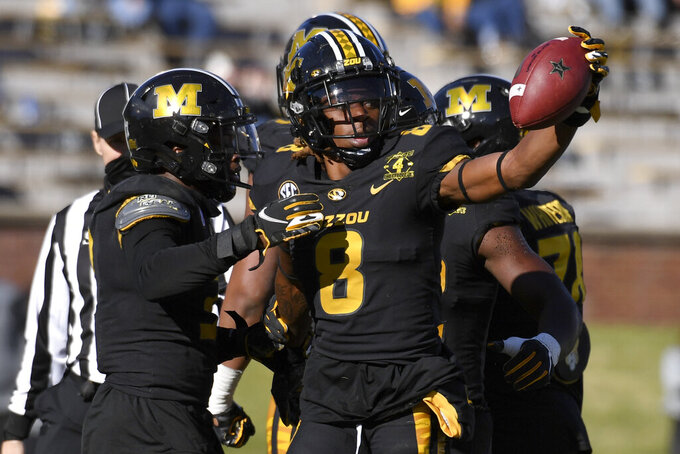 Missouri defensive back Jarvis Ware (8) celebrates after recovering a fumble during the second half of an NCAA college football game against Vanderbilt Saturday, Nov. 28, 2020, in Columbia, Mo. (AP Photo/L.G. Patterson)