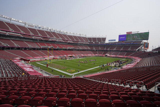 FILE - In this Sept. 13, 2020, file photo, empty seats are shown at Levi's Stadium during the first half of an NFL football game between the San Francisco 49ers and the Arizona Cardinals in Santa Clara, Calif. California health officials announced Tuesday, Oct. 20, 2020, that they will allow a limited number of fans to attend professional sporting events in counties with lower rates of transmission of the coronavirus. That includes Santa Clara County, home to the San Francisco 49ers professional football team, but health officials there said they won't allow fans at such events anytime soon. (AP Photo/Jeff Chiu, File)
