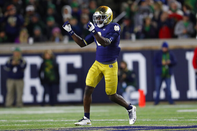 Notre Dame linebacker Jeremiah Owusu-Koramoah (6) celebrates sacking Southern California quarterback Kedon Slovis in the first half of an NCAA college football game in South Bend, Ind., Saturday, Oct. 12, 2019. (AP Photo/Paul Sancya)