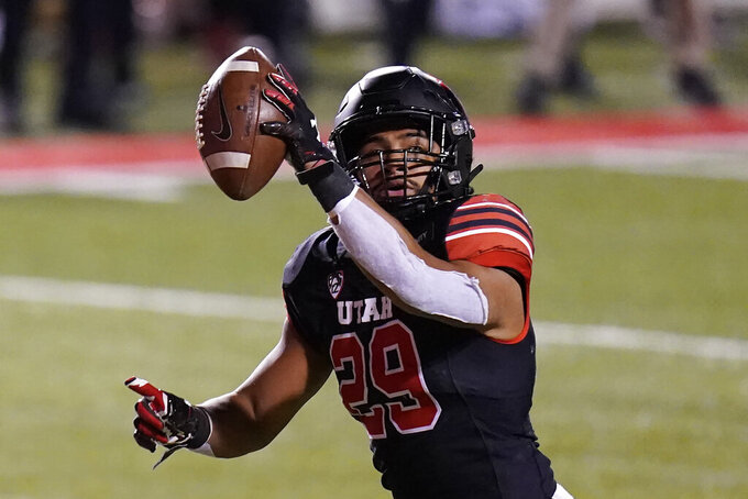 Utah linebacker Nephi Sewell scores after recovering a Southern California fumble during the first half of an NCAA college football game Saturday, Nov. 21, 2020, in Salt Lake City. (AP Photo/Rick Bowmer)