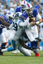 Buffalo Bills quarterback Josh Allen (17) is tackled by Carolina Panthers cornerback Corn Elder (29) during the first half an NFL preseason football game, Friday, Aug. 16, 2019, in Charlotte, N.C. (AP Photo/Brian Blanco)