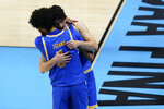 UCLA guard Jaime Jaquez Jr., rear, hugs teammate guard Johnny Juzang after a men's Final Four NCAA college basketball tournament semifinal game against Gonzaga, Saturday, April 3, 2021, at Lucas Oil Stadium in Indianapolis. Gonzaga won 93-90 in overtime. (AP Photo/Darron Cummings)