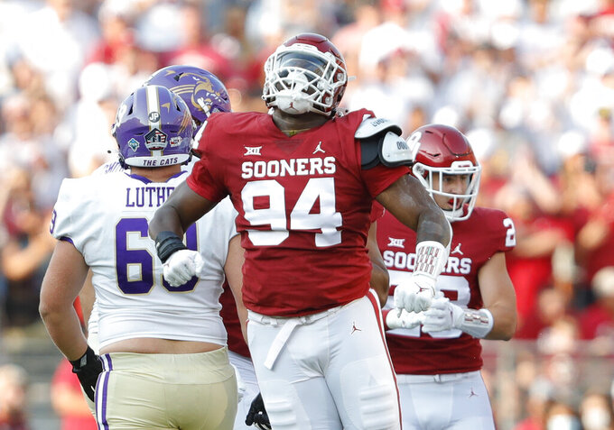 Oklahoma defensive lineman Isaiah Coe (94) celebrates after a tackle against Western Carolina during the first half of an NCAA college football game Saturday, Sept. 11, 2021, in Norman, Okla. (AP Photo/Alonzo Adams)