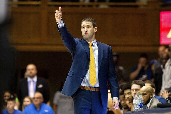 Brown head coach Mike Martin directs his team during the first half of an NCAA college basketball game against Duke in Durham, N.C., Saturday, Dec. 28, 2019. (AP Photo/Ben McKeown)